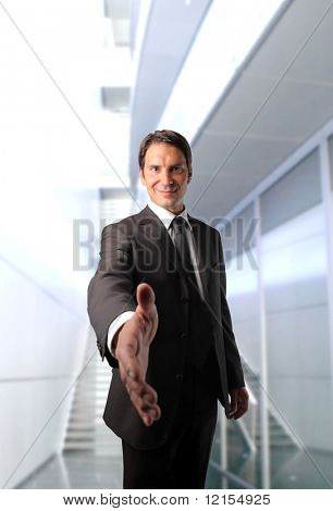 business man with open hand ready to seal a deal