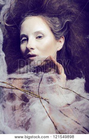beauty woman with creative make up like cocoon, halloween celebration creepy