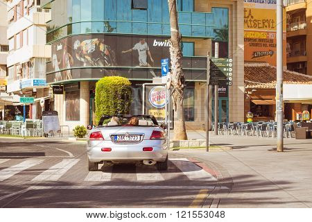 Chrysler Sebring Modern Coupe-cabriolet Drive On Sunny Street, Torrevieja, Valencia, Spain