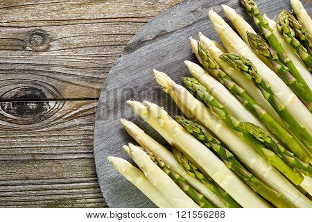 Bunch of fresh green and white asparagus on wooden background rustic style copy space