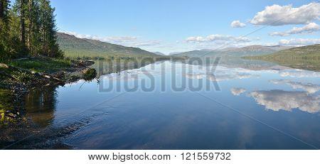 Panorama. Lake in the Putorana plateau. Summer water landscape in Taimyr.