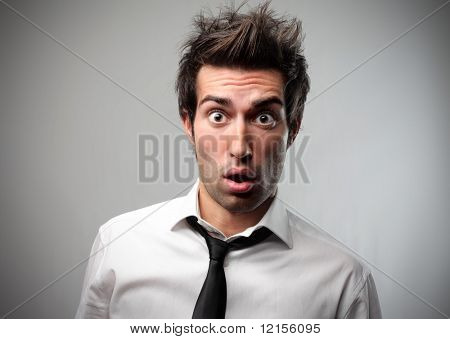 portrait of astonished businessman