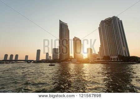 View of Bangkok from Chao Phraya river during sunset. Thailand.