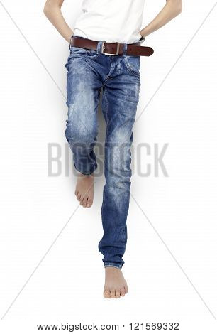 Teenager In Blue Jeans And A White T-shirt, Barefoot, Isolated.