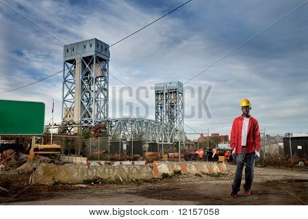 african worker in erection yard