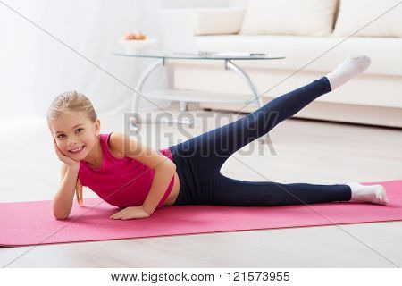 Girl doing exercises lying on the mat