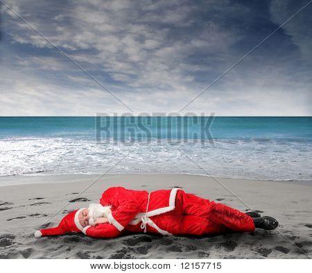 santa sleeping on the beach