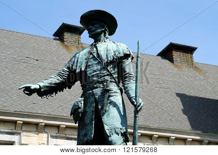 JOLIET, ILLINOIS / UNITED STATES - APRIL 12, 2015: This statue of Louis Joliet, sculpted by Sigvald Asbjornsen, was erected in its present place in front of the Joliet Public Library in 1903.