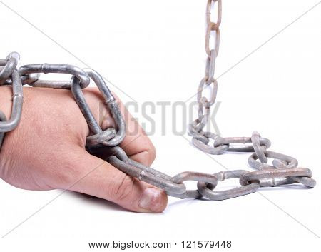 Man's hand and a metal chain on white background