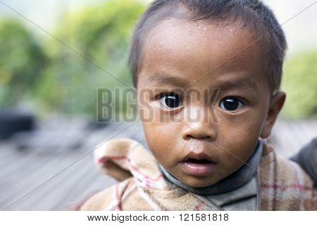 MINDAT, MYANMAR - DECEMBER 8, 2015: Photo of a Chin tribe child. Chin people, also known as the Kukis are a number of Tibeto-Burman tribal people.
