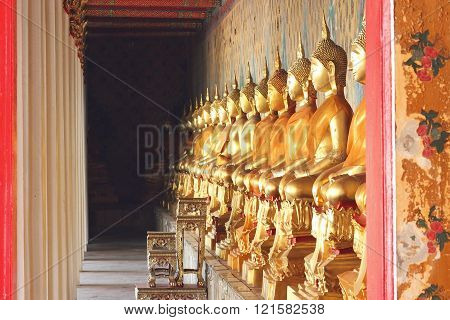 Bangkok- Thailand : March 4, 2016  Buildings and Gold Buddha statues and clothed in yellow robe at Wat Arun, vintage style