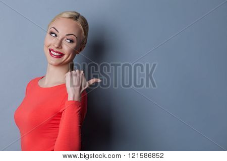 Cheerful young woman is gossiping with mockery