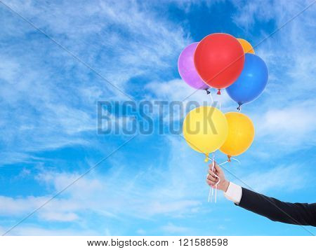 Business Hand Holding Colorful Balloons