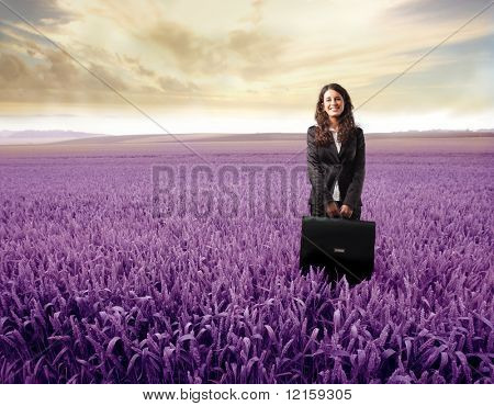 Portrait of a businesswoman standing on a purple meadow