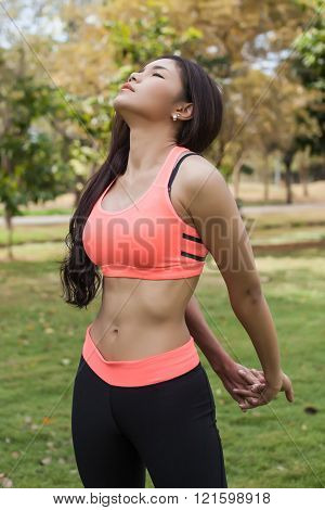Asian Fitness Woman Stretching in the park