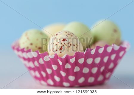 Closeup of chocolate speckled Easter eggs in cupcake liner