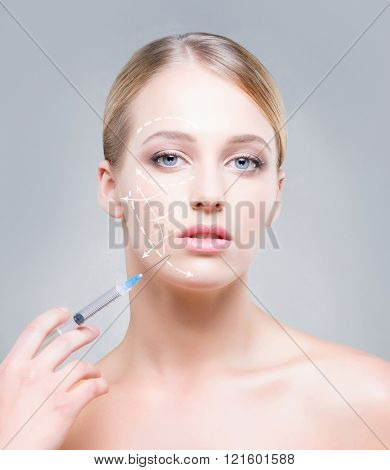 Close-up portrait of young, beautiful and healthy woman ready for a injection