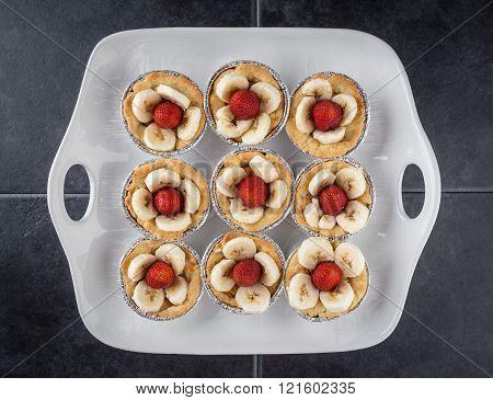 Nine Tartlets On White Dish.