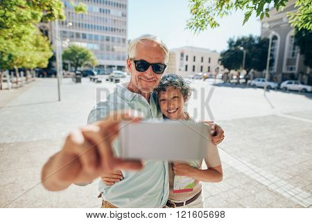 Loving Senior Couple Taking A Selfie