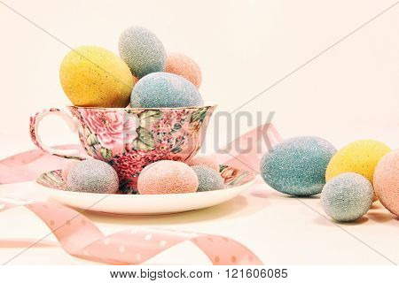 Decorative easter eggs in china tea cup