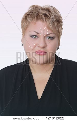Portrait of fat woman with arrows on her face