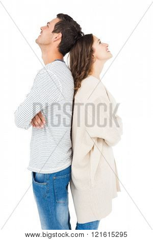 Couple standing back to back on white background