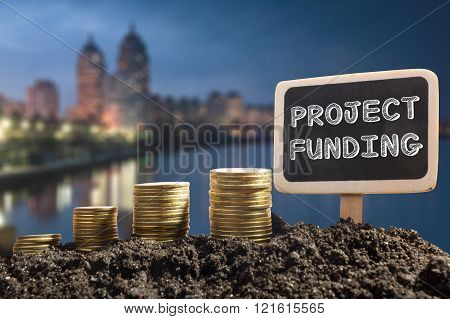 Project funding. Financial opportunity, business and intertnet concept. Golden coins in soil Chalkbo