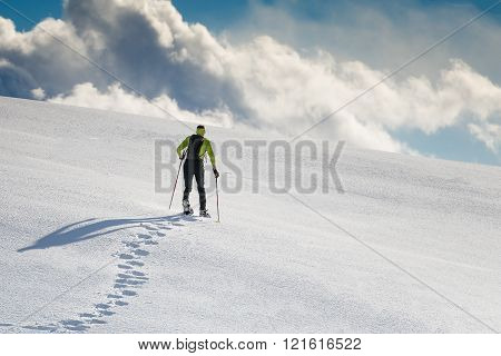 Man With Snowshoes On Snow