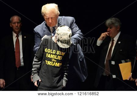 Saint Louis, MO, USA - March 11, 2016: Donald Trump signs shirt of boy the Peabody Opera House in Downtown Saint Louis