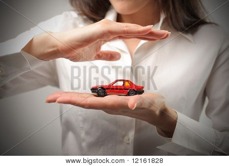 Woman holding the model of a car