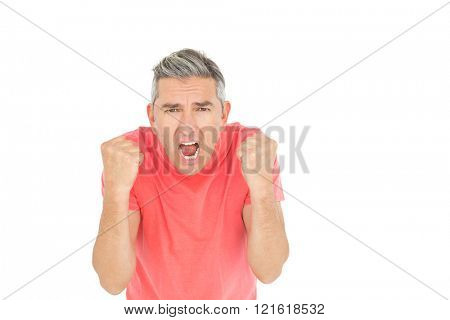 Angry man shouting in front of the camera on white backround