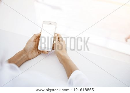 Female is reading on cell telephone financial news