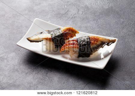 Set of unagi sushi on stone table