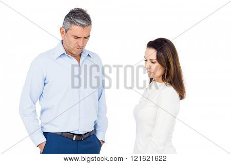 Couple ignoring each other against white background