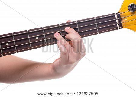 Fingers on bass guitar