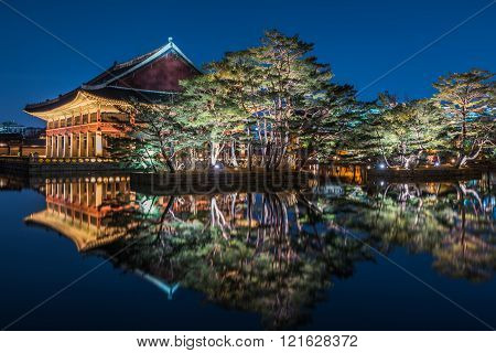 Reflection Of Gyeongbokgung Palace At Night In Seoul, South Korea.