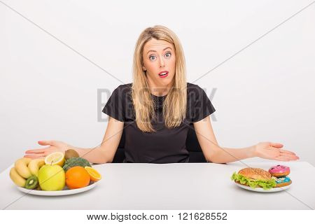 Woman deciding between healthy and unhealthy lifestyle