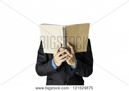 A guy in black suit holding notebook, selective focus, isolated on white background