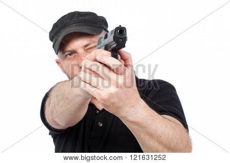 Man Pointing Gun, Isolated On White. Focus On The Gun