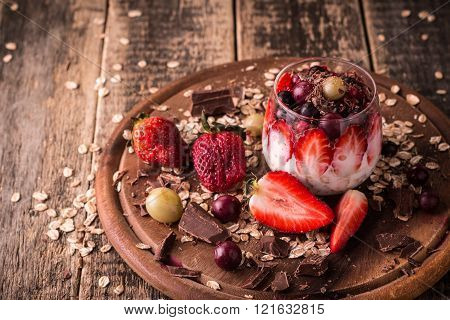 Breakfast parfait with homemade granola and yogurt on wooden table healthy food