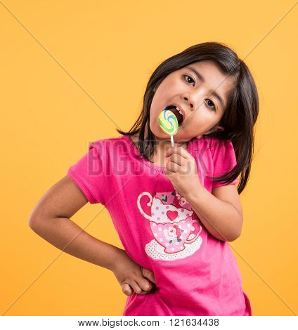 indian small girl with lollipop or loly pop, asian girl and lollipop or lolypop