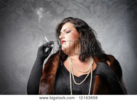 Fat woman wearing a fur and smoking a cigarette