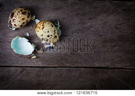 Quail eggs on wooden background.