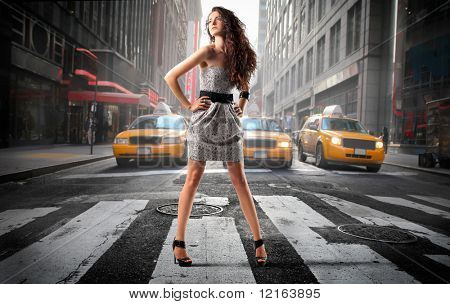 Beautiful elegant woman on a city street