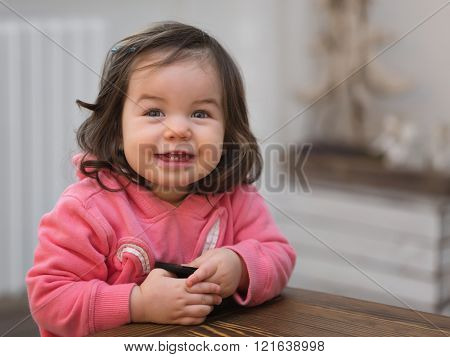 Cute smiling small baby girl