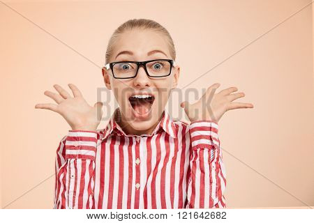 Close-up Portrait Of Surprised Beautiful Girl Holding Her Head In Amazement And Open-mouthed. Over C