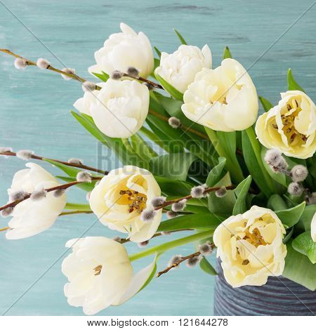 White tulips and willow branch. Easter concept