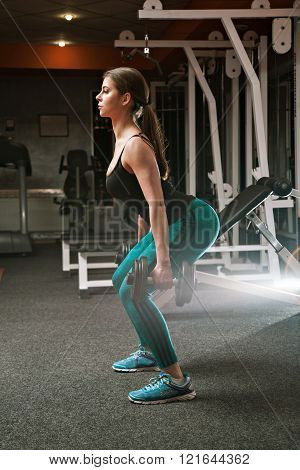 Girl Squat In The Gym With Weights