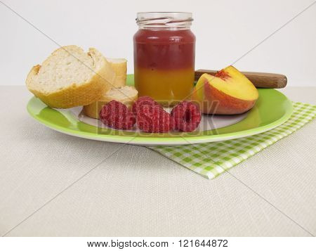 Breakfast with bicolor peach and raspberry jam