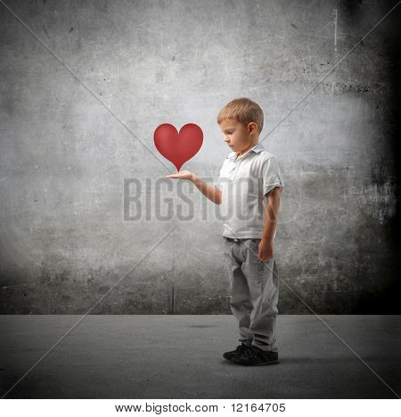Child holding a heart in his hands